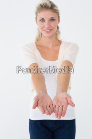 attractive young woman presenting your product