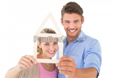 attractive young couple looking through house
