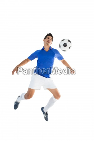 fit player kicking football
