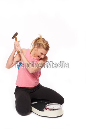 young woman skin with a hammer