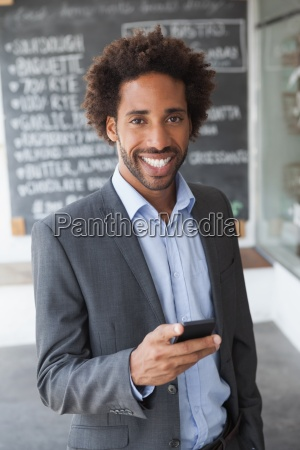 handsome, businessman, texting, on, phone - 13747479