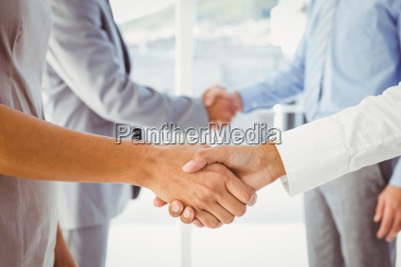 two fellow employees shaking hands