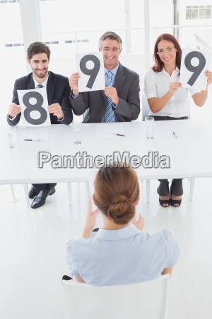 businesswoman getting her interview rating