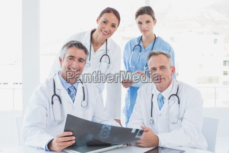 doctor holding up an x ray