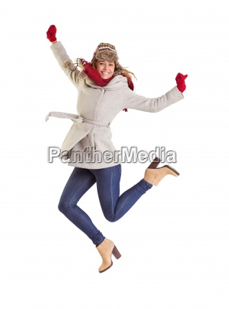 happy blonde in winter clothes posing