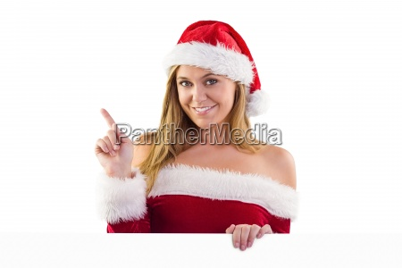 festive blonde smiling and pointing