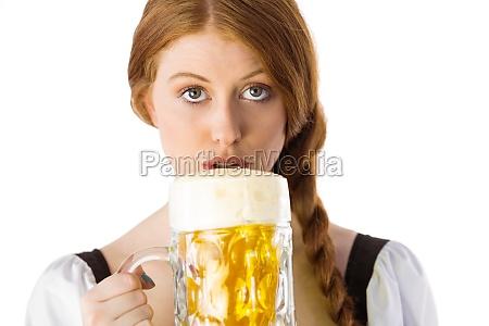 oktoberfest girl drinking jug of beer