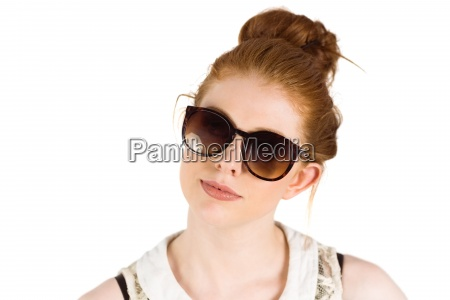 hipster redhead wearing large sunglasses