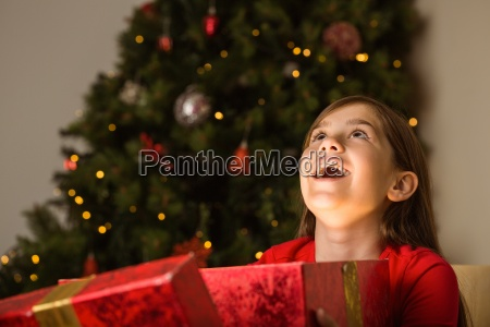 little girl opening a magical christmas