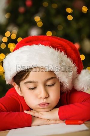 little girl writing letter to santa