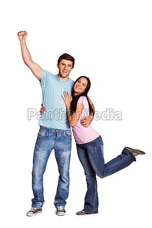 young couple cheering at camera