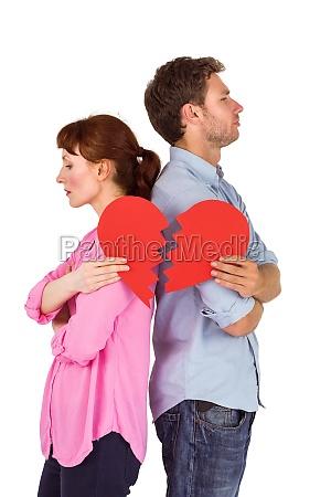 couple holding a broken heart