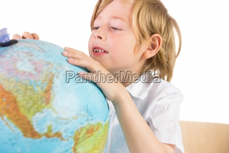 student learning geography with globe