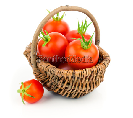cherry tomatoes in the wicker basket
