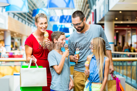 family with kids in shopping mall