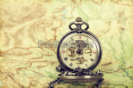 vintage watch on antique map