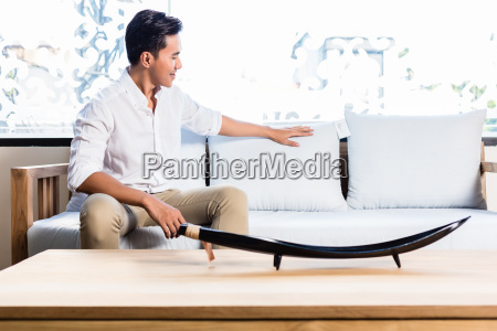 asian man on sofa couch in