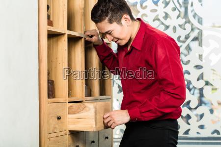 korean man shopping cabinet in furniture