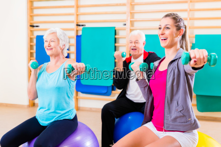 seniors on medicine ball playing sports