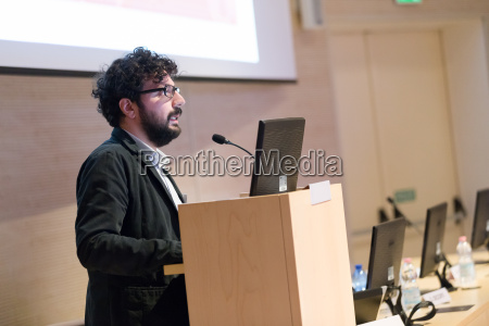 speaker giving talk on podium at