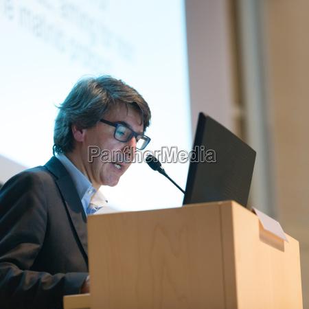 speaker, giving, talk, on, podium, at - 13782329