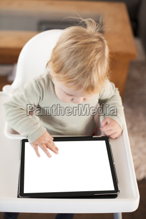 baby touching screen tablet