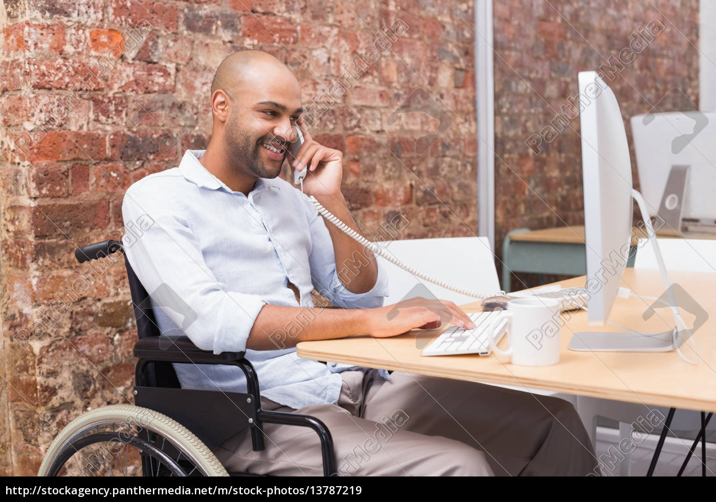 businessman, in, wheelchair, working, at, his - 13787219