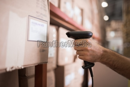 close up of worker holding scanner