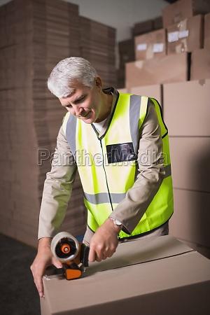worker preparing goods for dispatch