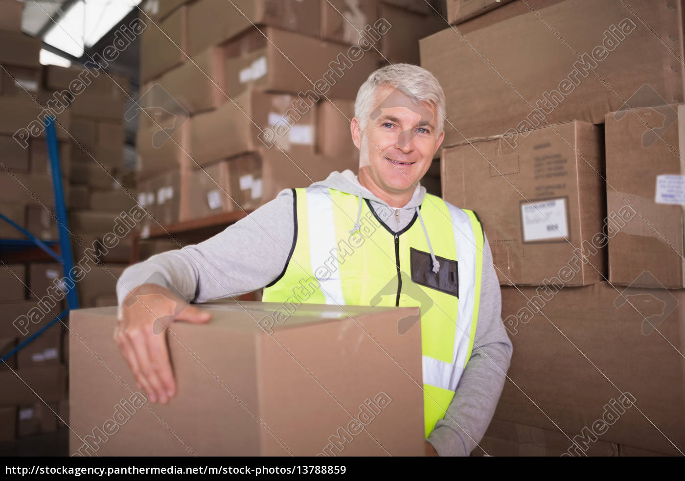 worker, carrying, box, in, warehouse - 13788859