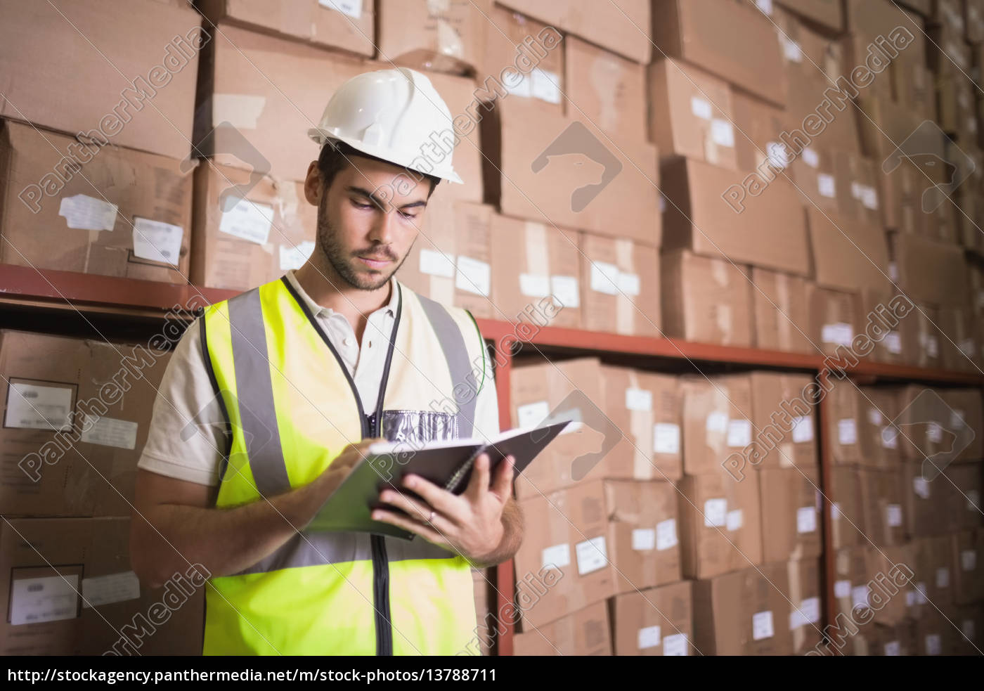worker, with, diary, in, warehouse - 13788711