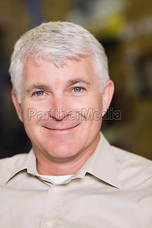 close up portrait of smiling workman
