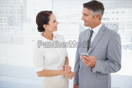 businessman talking with co worker