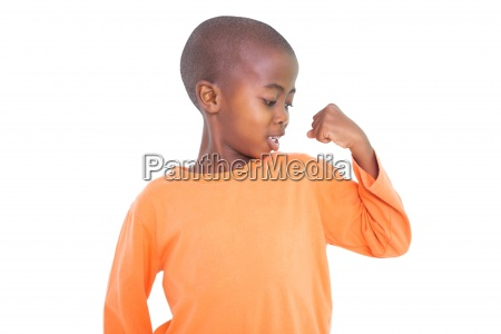 cute boy flexing his arm