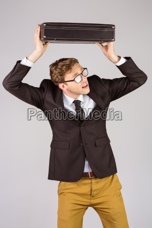 young geeky businessman holding briefcase