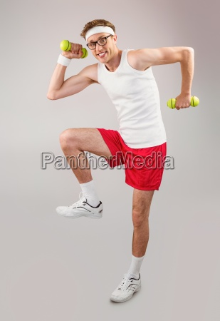 geeky hipster posing in sportswear with