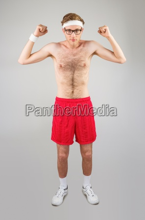 geeky shirtless hipster flexing biceps