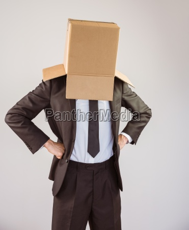 anonymous businessman with hands on hips