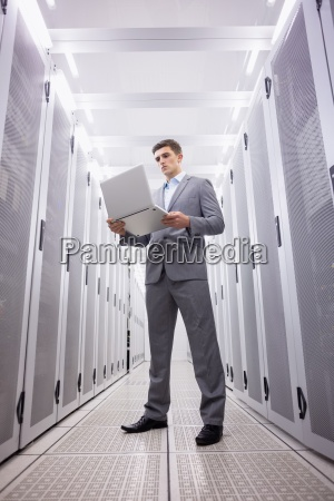 concentrated technician in suit standing