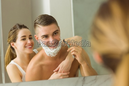 woman putting shaving foam on boyfriends