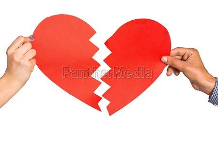 two hands holding broken heart