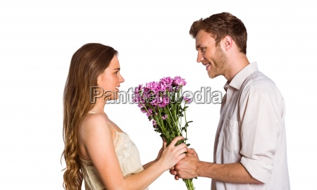 side view of couple holding flowers
