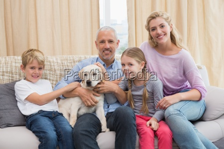 parents with their children on sofa
