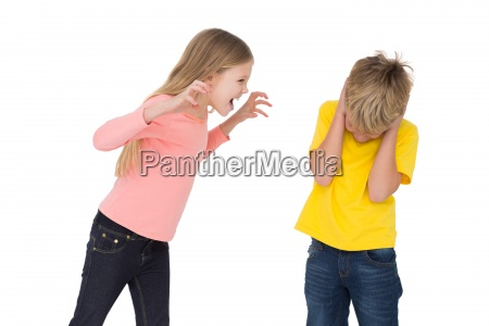little girl scaring her brother