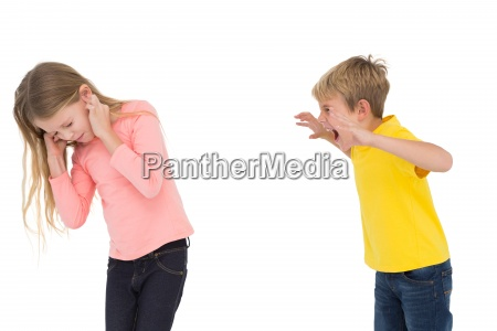 little boy scaring his sister