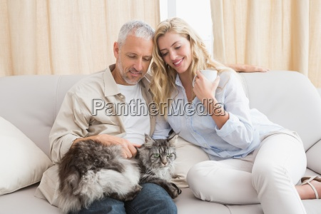 happy couple with pet cat on