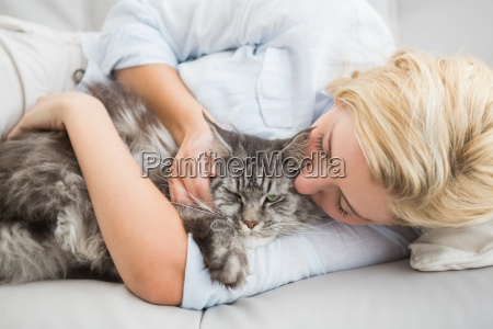 happy blonde with pet cat on