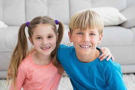 happy siblings smiling at camera together