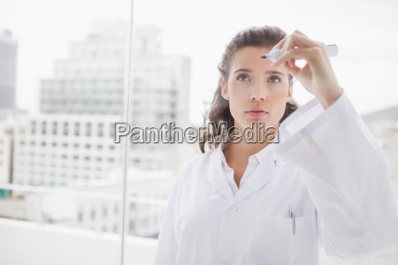 concentrated doctor writing on the board