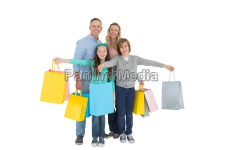 portrait of smiling family with shopping